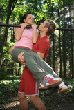 Couple exercising on horizontal bar