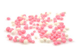 pink and white mice sprinkles over white background