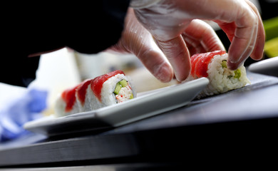 Serving sushi and rolls on plate