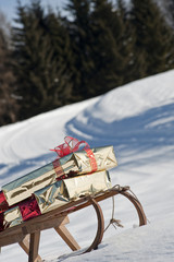 Sleigh with presents in snowy landscape