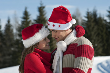 Couple in Christmas outfit embracing