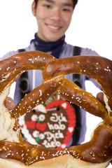 Man holding Oktoberfest Pretzel - Mann hält Wiesn Brezn