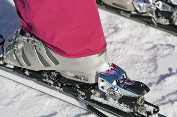 Closeup of boot in ski binding