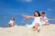 Children in sand on beach