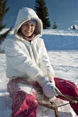 Young woman sledding