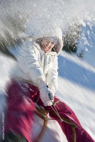 Young woman sledding