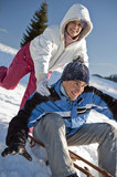 Couple sledding