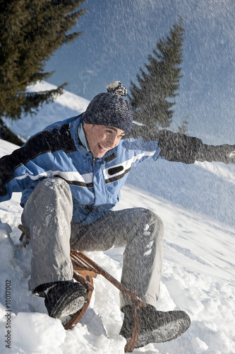 Young man sledding
