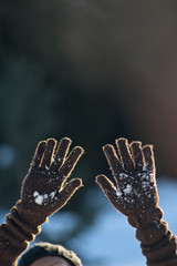 Woman's hands wearing gloves