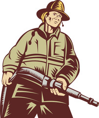 Fireman or firefighter holding a fire hose