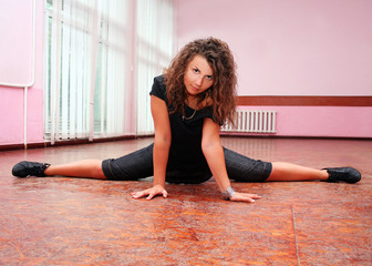 Young teenage girl stretching