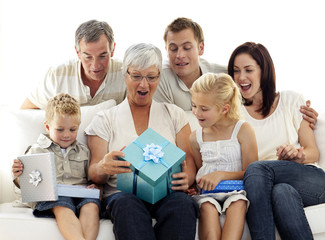 Family opening presents in grandmother's birthday