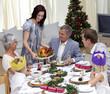 Happy family celebrating Christmas dinner with turkey