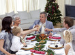 Family tusting in a Christmas dinner with champagne