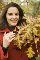 Woman with leaves in autumn