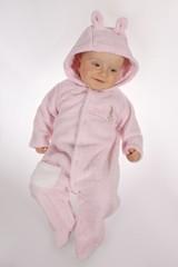 baby boy in pink rabit get-up