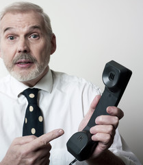 homme d'affaires combiné téléphone