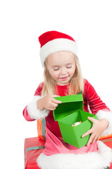 Christmas toddler with present boxes, studio shot