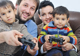 Happy members of young family isolated, playing video games poster