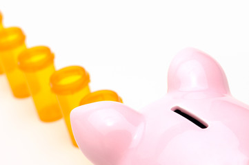Piggy Bank and Pill Bottles Isolated On White
