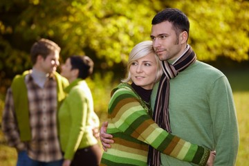 Young couples outdoor at autumn
