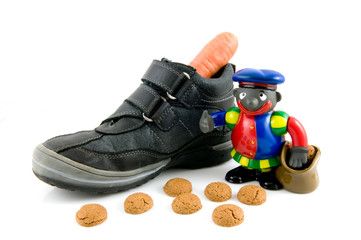 A shoe with carrot, pepernoten and black piet