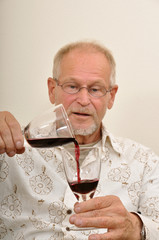 Senior testing wine