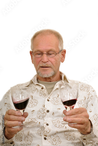 Senior man enjoying wine