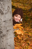 Fototapety Cute girl playing in autumn park