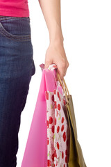 Image of female holding shoppingbags in her hand isolated on whi