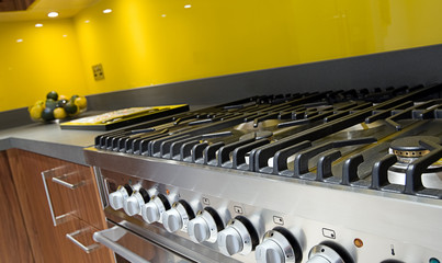 Close Up Shot Across Cooker in Modern Colourful Kitchen