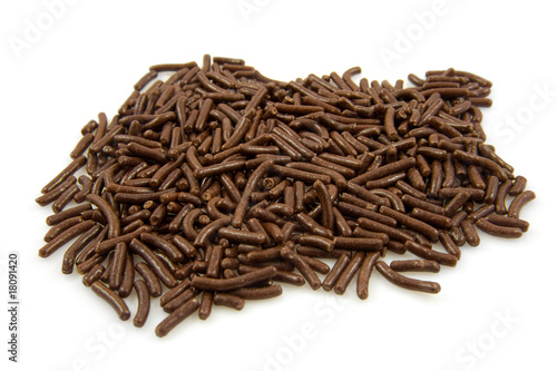 pile op Dutch chocolate sprinkles over white background