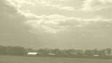 Rural Time Lapse of Past (Sepia) to Present (Color) with Clouds