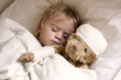 Leinwanddruck Bild - boy and teddybear in bed