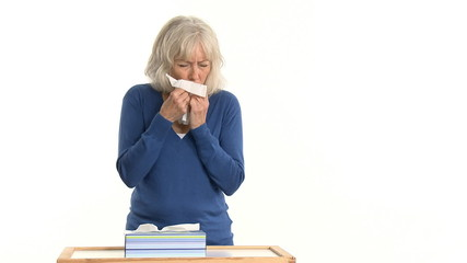 senior woman sick with the flu