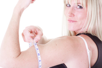 woman measuring arm