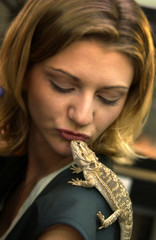 Lizard on womans shoulder