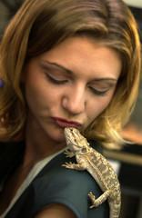 Lizard on womans shoulder