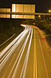 Long exposure of urban night traffic, focus on the road