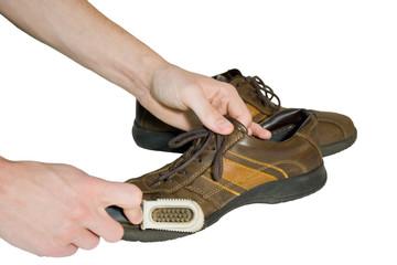Man brush shoes