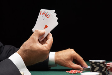 Poker player winning hand of cards royal flush