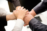 Business team joining hands poster