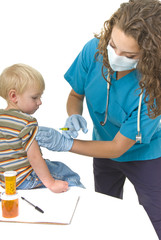 Health care professional gives injection to toddler