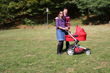 young couple and pram
