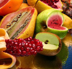 Concept photo of the modified fruits on a mirror