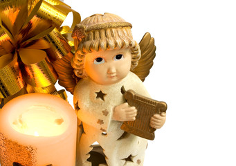 christmas angel with gold wings and harp, fire candle and bow
