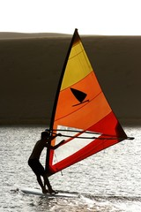 Windsurfer Silhouetted on Lake