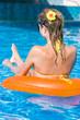 Blonde girl in swimming pool