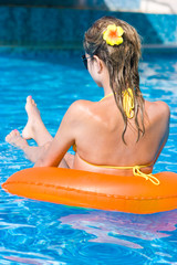 Blonde girl in swimming pool