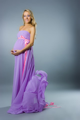 Young pregnant blonde woman